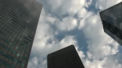 Office towers in Tokyo with clouds, time lapse business district Japan Stock Footage