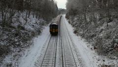 Train on snowy tracks 1 Stock Footage