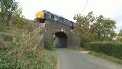 Diesel Locomotive (37215) Passing Over Road Bridge Stock Footage