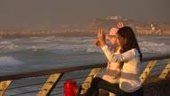 Boardwalk silhouette sunset Stock Footage