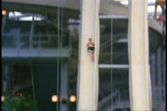West Edmonton Mall, Edmonton, Alberta, Canada, man down waterslide Stock Footage