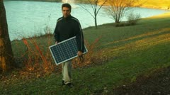 Walking with solar panel Stock Footage
