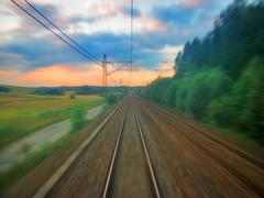 Scenic railroad sunset with motion blur - stock photo