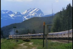 """The Canadian"" train, in the mountains, classic far shot, wide shot Stock Footage"