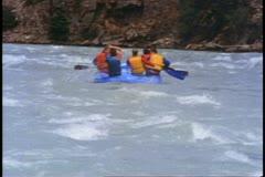 Jasper Park Lodge, Alberta, Canada, white water rafting, group paddle Stock Footage