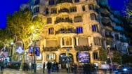 Stock Video Footage of La Pedrera or Casa Mila at dusk, Barcelona, Spain