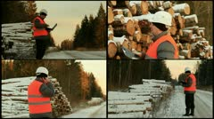 Forester near  log pile Stock Footage