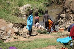 African Children at the River's Edge Stock Photos
