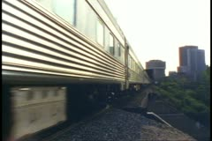 """The Canadian"" train, passby, low, train pulling into Winnipeg Stock Footage"