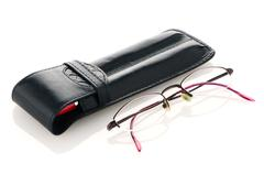 leather pencil case and glasses - stock photo