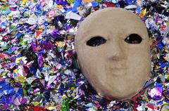 Carnival mask and confetti Stock Photos