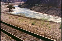 British Columbia, Canada, Frasier River, two railroad tracks, train moves Stock Footage