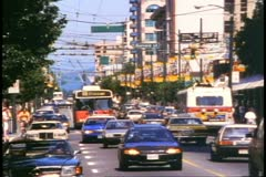 Vancouver, British Columbia, busy traffic shot, buses, cars,1990 Stock Footage