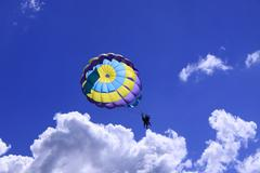 Parachute tandem on the blue sky - stock photo