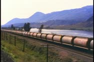 Stock Video Footage of British Columbia, Canada, wheat railcars, cylindrical, freight train