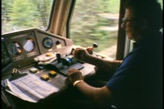 "Engineer in the locomotive of ""The Canadian"" driving the train - stock footage"