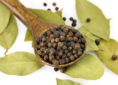 Black pepper and bay leaves Stock Photos