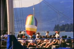 Vancouver, British Columbia,  waterfront cafe, sail of boat billowing, 1990 Stock Footage
