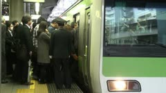 Passengers enter local commuter train during rush hour in Tokyo Stock Footage