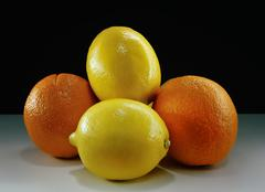 Lemons and Oranges - stock photo