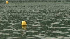 Water buoy floating in lake Stock Footage