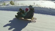 Family mother and kids on sled snow rural road HD 007 Stock Footage
