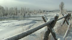 P02478 Scenic Shot of Gros Ventures River and Fence in Winter Stock Footage
