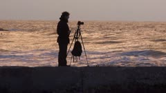 Photographer silhouette sunset Stock Footage