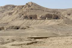 rock cut tombs near mortuary temple of hatshepsut - stock photo