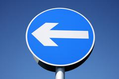 british left turn only one way sign. - stock photo