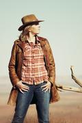 Stock Photo of beautiful blond cowgirl in the desert