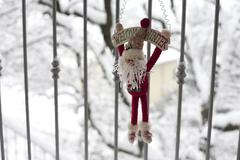 Winter puppet on a snowy background Stock Photos