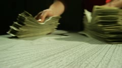 Handing Over Two Piles of Cash Stock Footage