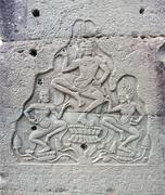 dancing apsara on the wall in temple prasat bayon - stock photo
