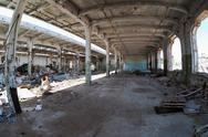 Ruins, view of an old abandoned industrial interior Stock Photos