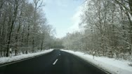 Winter road through the forest - timelapse Stock Footage