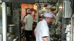 Sushi restaurant, kitchen, Tsukiji fish market, Tokyo, Japan Stock Footage