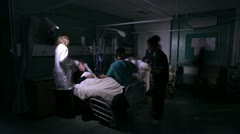 Night time time lapse footage of the bustle and activity on a UK hospital ward Stock Footage