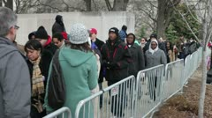 Groups of people walking to 2013 inauguration Stock Footage