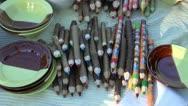 Decorative wooden pencils in summer market Stock Footage