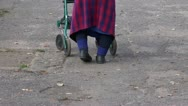 Elderly disabled woman with special walker Stock Footage
