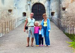 Evening svirzh  (ukraine) castle entrance gate and family near. Stock Photos
