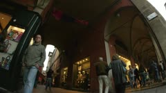 People on streets of Bologna city, Italy - stock footage