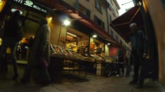 People on market streets of Bologna city, Italy - stock footage