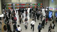 Stock Video Footage of Shinjuku station rush hour, people going home after work, Tokyo, Japan