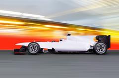 Formula one car on empty road Stock Photos