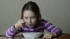 Little girl eating cereal Stock Footage