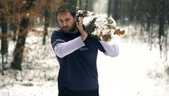 Lumberjack strong man carrying downed log Stock Footage