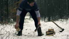 Lumberjack strong man collecting downed log Stock Footage