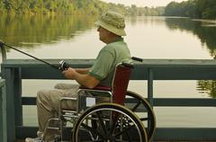 disabled fisherman - stock photo